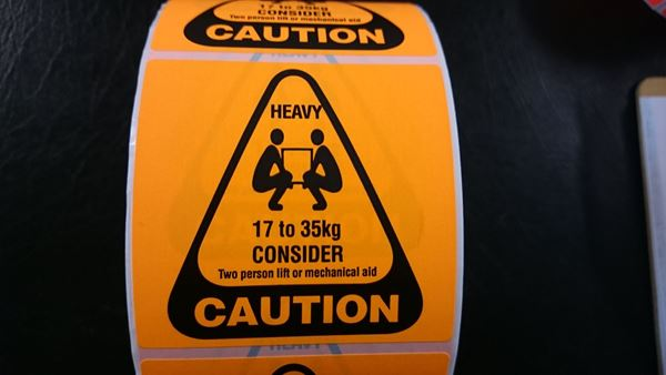 Picture of Fluro Orange 75mm x 75mm with HEAVY 17 to 35kg, CAUTION, 76mm core, 1 across Label, 2,000per roll